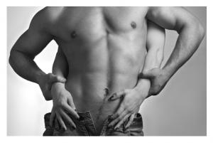 Womans' hands on male torso