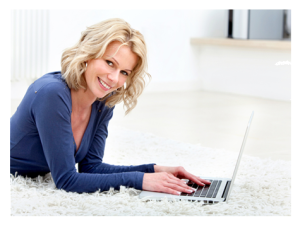 Woman on her laptop smiling