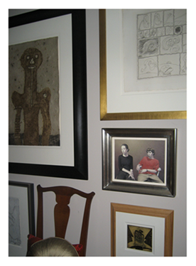 Pictures displayed salon style Partial Wall
