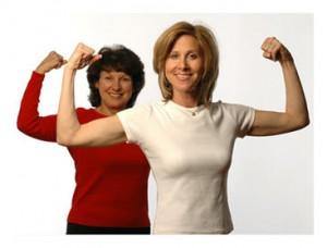 Women flexing their muscles