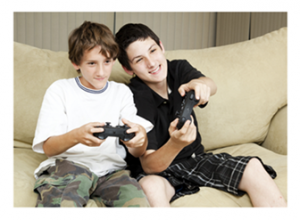 Boys playing video games together