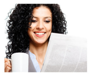 Woman Reading the News with Coffee