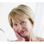 Mature woman gazing in mirror