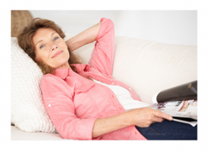 Woman relaxing with magazine