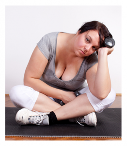 Overweight woman tired of exercising