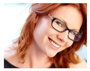 Smiling Woman Red Hair and Glasses
