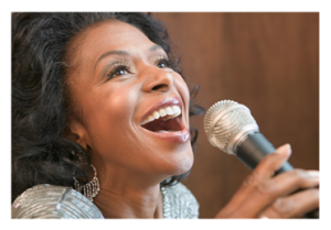 Woman belting out a song