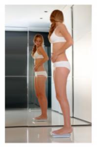 Woman scrutinizing herself in the mirror