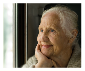 Lovely Older Woman Looking Out Window