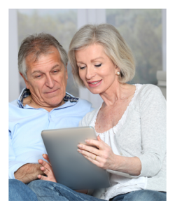 Mature Couple Reading Together on the Internet