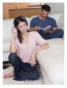 Man Reading Woman Listening to Music