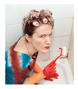 Scowling Woman Scrubbing Bathtub