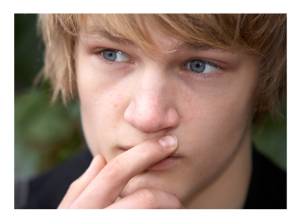 Teenage Boy Lost in Thought