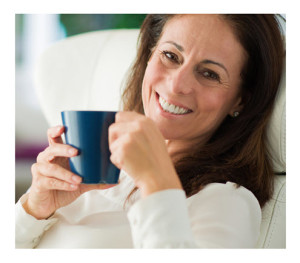 Woman Drinking Coffee Smiling