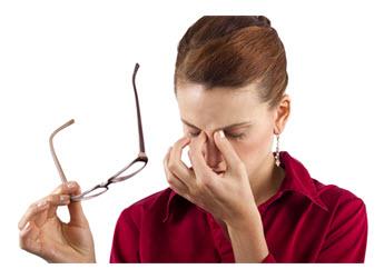 Working Woman with Eye Strain