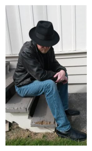 Man in Fedora on Stoop