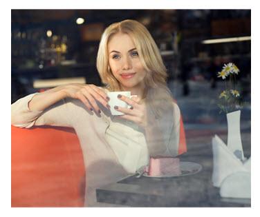 Woman Enjoying Dessert in Cafe