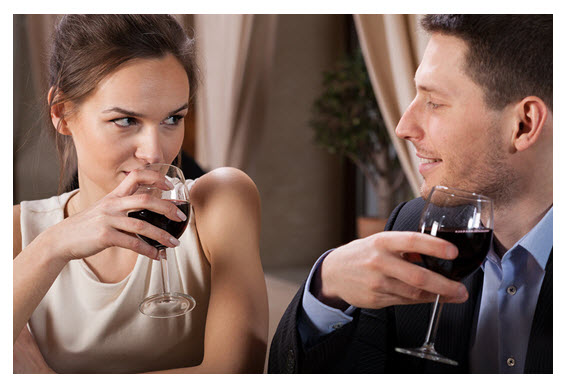 Couple Sipping Red Wine in Restaurant
