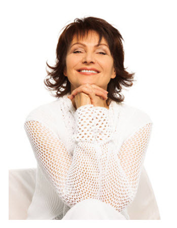 Confident Woman in White Smiling
