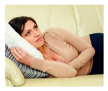 Woman Thinking on Couch
