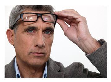 Man Raising His Glasses Thinking