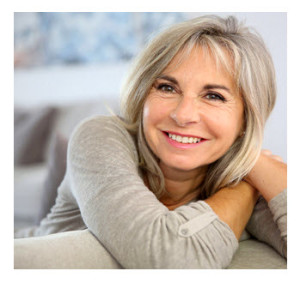 Smiling Mature Woman Leaning on Couch