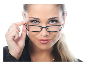 Young Businesswoman Peering Over Glasses