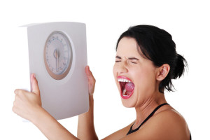 Frustrated Woman With a Scale