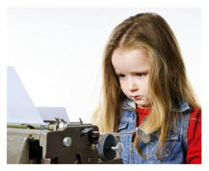 Little Girl on Vintage Typewriter