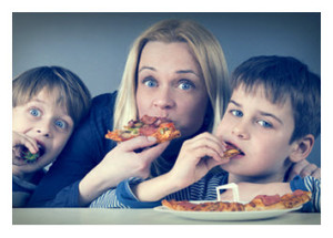 Mother and Sons Eating Pizza