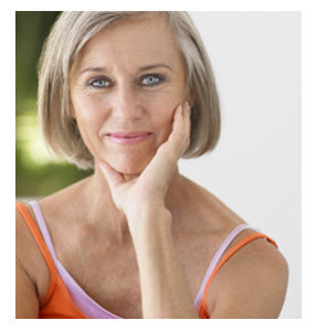 Smiling Middle Age Woman in Orange Shirt