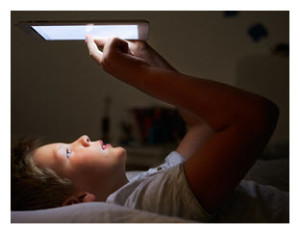 Boy with Tablet in Bed