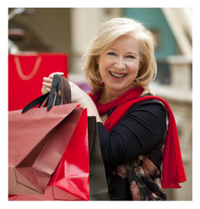 Happy Mature Woman With Shopping Bags