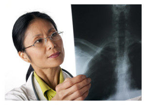 Physician Looking at X-rays