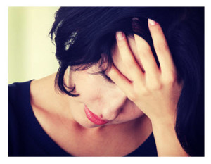 Sad Young Woman Holding Her Head in Her Hand