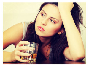 Depressed Young Woman With Alcohol