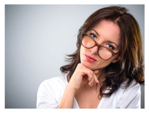 30 Year Old Woman Looking Over Her Glasses