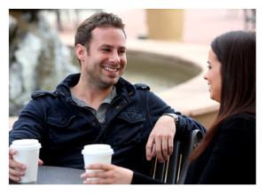 Couple Having Coffee Outside
