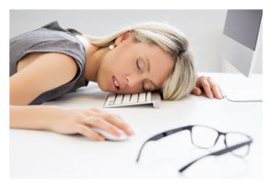 Exhausted Woman Asleep at Computer