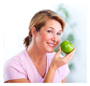 Healthy Organic Eating_Smiling Woman Holding an Apple