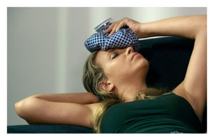 Woman With Headache and Ice Pack