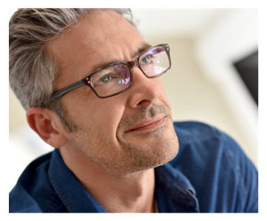 Handsome Mature Man in Glasses Thinking
