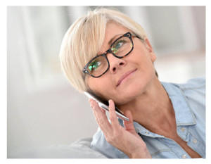 Midlife Woman Wearing Glasses With Smartphone