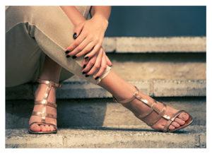 womans-legs-in-heels-sitting-on-stairs