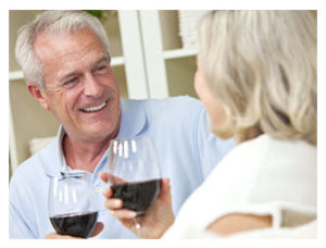 happy-midlife-couple-sharing-talk-and-wine