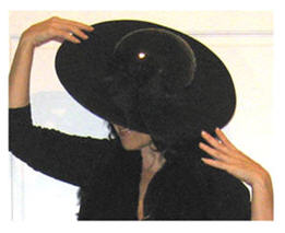 A gorgeous hat goes far in life I think; 'Specially if the damn thing isn't pink!