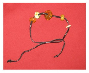 Latvian friendship bracelet of dzintars, now thought to be a good luck charm.