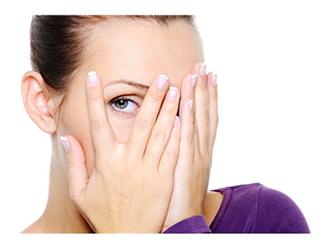 Woman Hiding her face but peeking out