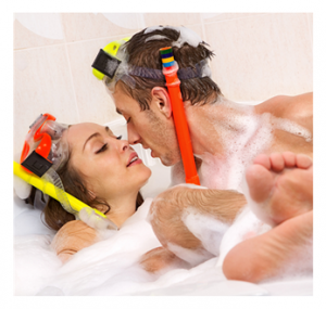 Playful couple in romantic bubble bath