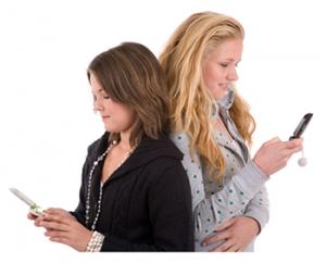 Teen girls sending texts